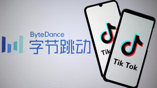 TikTok logos are seen on smartphones in front of a displayed ByteDance logo in this illustration taken November 27, 2019.