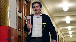 A file photo taken on April 30, 2015 shows Euclid Tsakalotos, then head of Greece's negotiating team in loan talks, arriving for a cabinet meeting at the Greek parliament in Athens.
