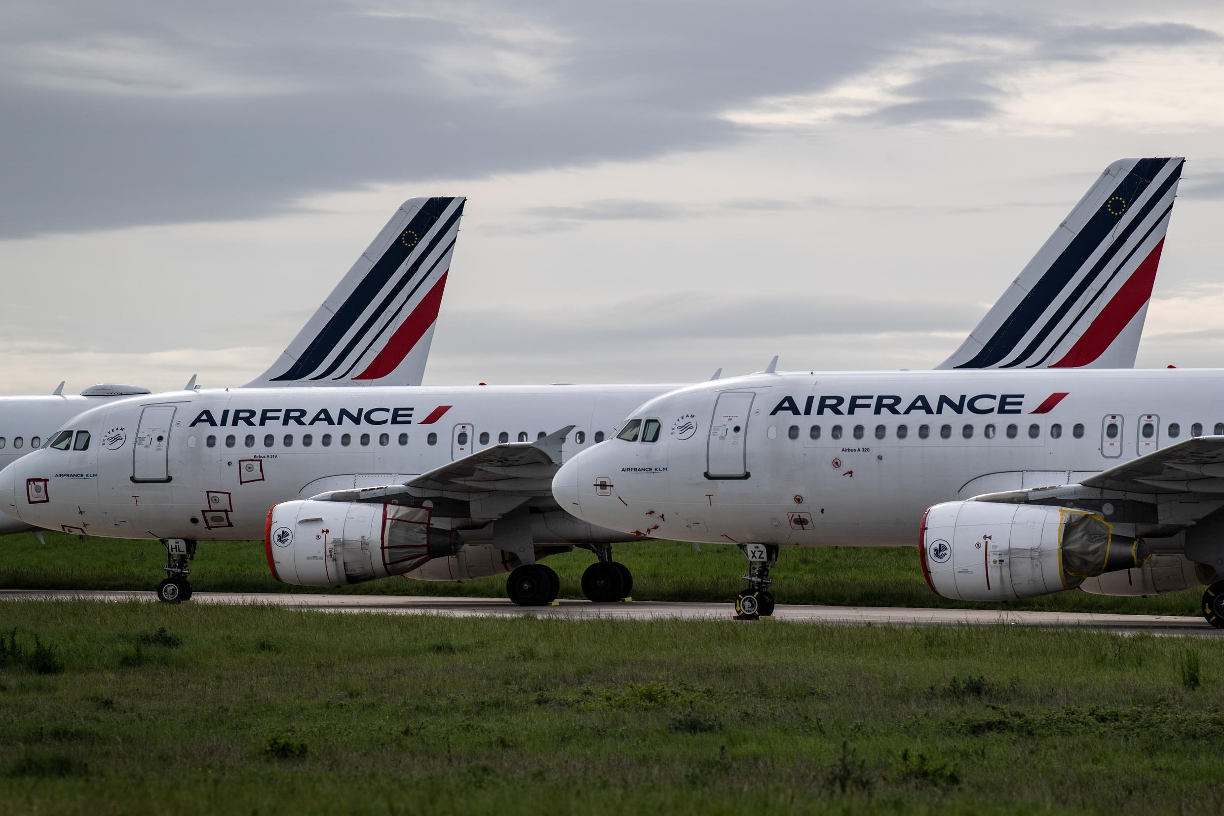 Air France planes remain parked on the runways at Paris-Charles de Gaulle airport on April 30, 2020.