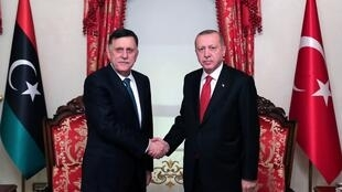 Turkish President Recep Tayyip Erdogan meets with Libya's internationally recognised Prime Minister Fayez al-Sarraj in Istanbul, Turkey on November 27, 2019.