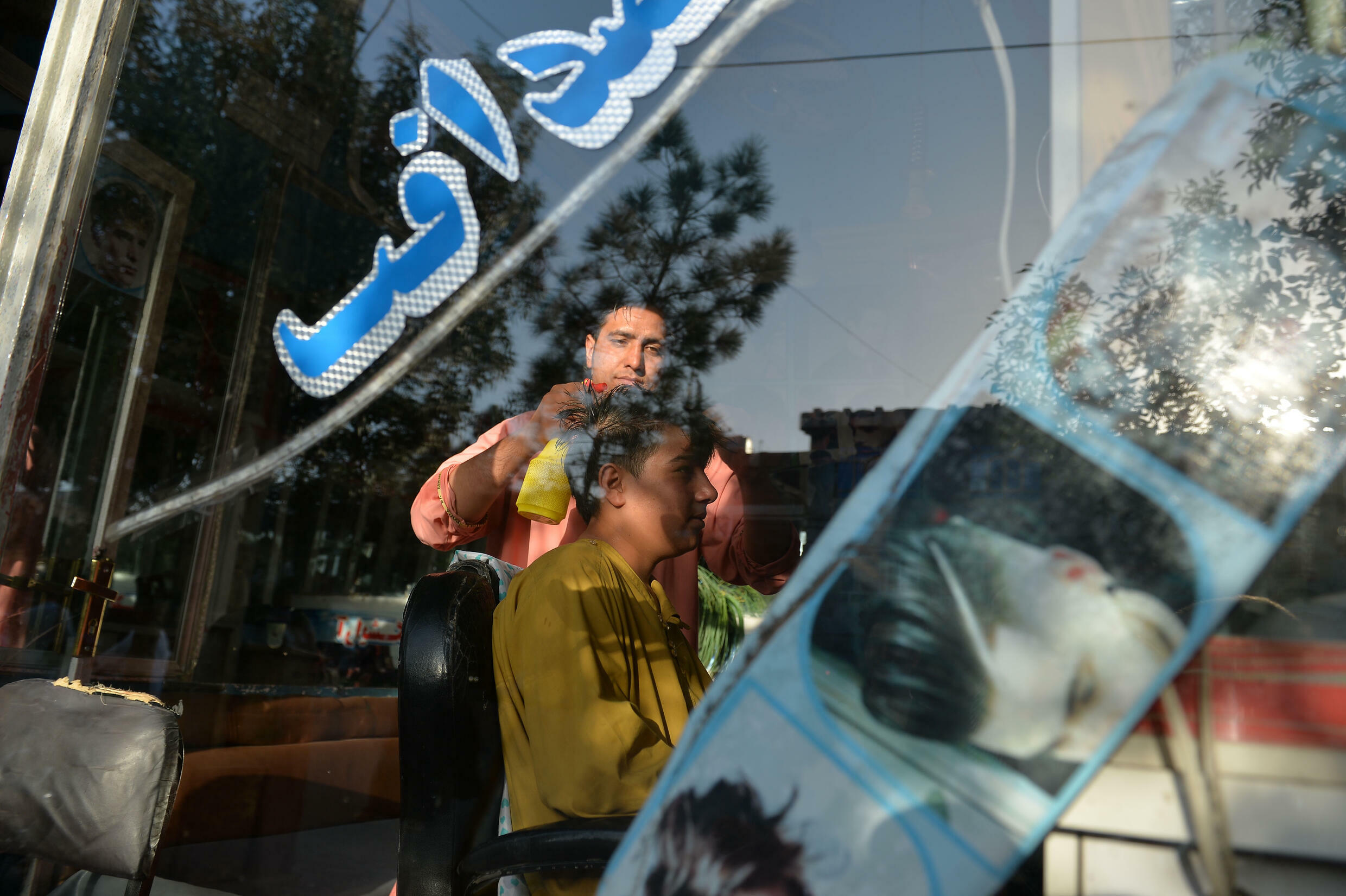 During the Taliban's rule from 1996 to 2001, hardliners banned flamboyant hairstyles and insisted that men grow beards.