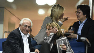 Former IMF head Dominique Strauss-Kahn and girlfriend Myriam L'Aouffir watch the French Cup final with Green Party Senator Jean-Vincent Placé on May 30, 2015