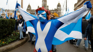 A demonstrator holds a flag during a pro-Scottish Independence rally in Glasgow, Scotland, November 2, 2019.