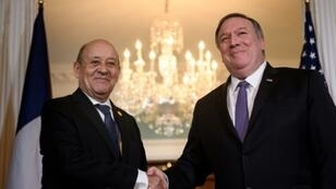 US Secretary of State Mike Pompeo (right) raises objections to France's plans to tax digital giants in a meeting in Washington with Foreign Minister Jean-Yves Le Drian