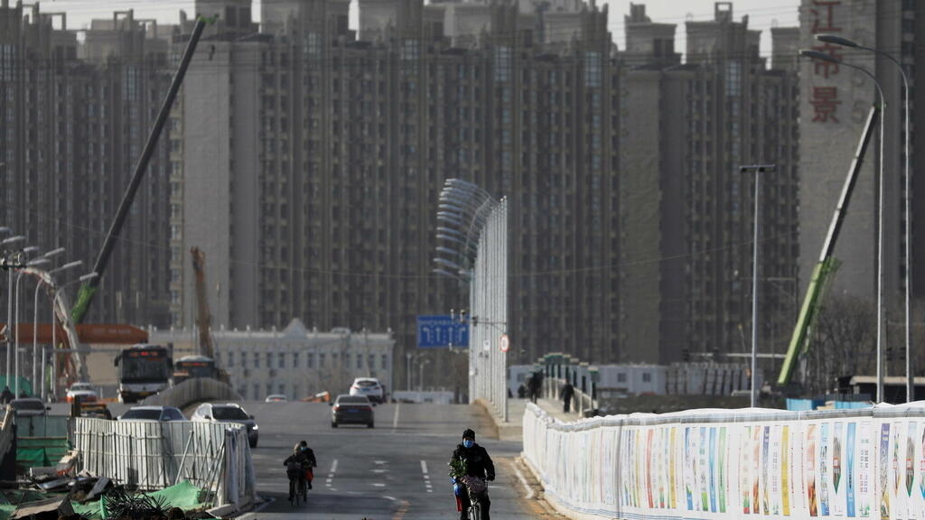 China's economy slows as covid, energy crisis and struggling property sector take toll