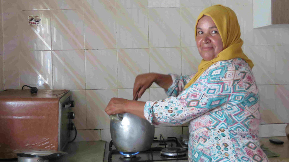 Cooking contest host Hinda Jlass prepares couscous in her kitchen.