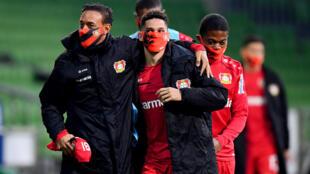 Bayer Leverkusen substitutes wore face masks during Monday's 4-1 win at Werder Bremen