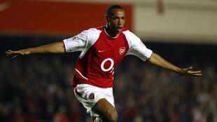 Thierry Henry celebrates after scoring Arsenal's second goal against Manchester United at Highbury on April 16, 2003