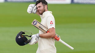 England's Dom Sibley celebrates reaching his century against the West Indies at Old Trafford