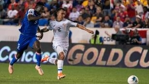 Haiti defender Djimy Bend Alexis (L) fights for the ball with Costa Rica midfielder Randall Leal in Haiti's 2-1 Gold Cup Group B victory at Red Bull Arena