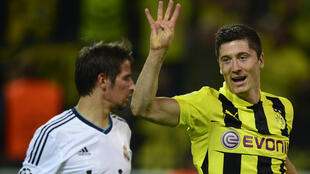 Robert Lewandowski celebrates his four goals for ex-club Dortmund against Real Madird in the Champions League semi-finals in April 2013