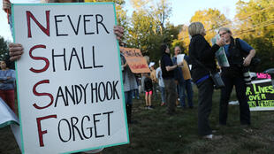 People in Newtown, Connecticut, attend a vigil remembering the 58 people killed in a shooting in Las Vegas on October 4, 2017.