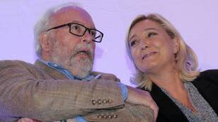 Wallerand de Saint-Just et Marine Le Pen lors d'un meeting pour les régionales en Ile-de-France, en septembre 2015.