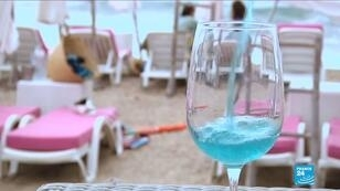 Screengrab | A glass of Vindigo, Mediterranean chardonnay wine, is seen at a beachfront restaurant in Sete, France, August 9, 2018. The wine is filtered through a pulp of red grape skins which contain a natural pigment, anthocyanin, and gives the wine its blue colour.