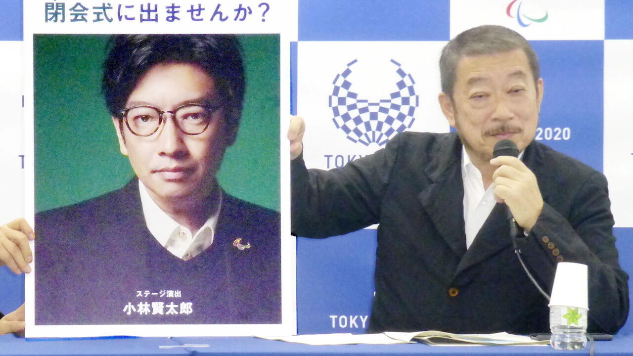 In this 2019 photo, Hiroshi Sasaki, then executive creative director Tokyo 2020 Paralympic Games, displays a portrait of Olympics opening ceremony show director Kentaro Kobayashi. Both men have since stepped down from their roles amid scandals.