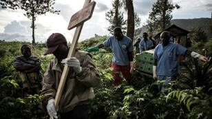 Health workers dig the graves and bury the victims of Ebola in a bid to prevent the disease from spreading