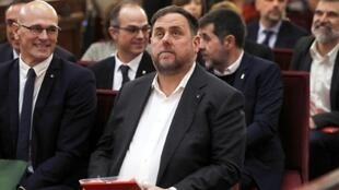 Former Catalan vice-president Oriol Junqueras (C, pictured February 2019 has been in pre-trial detention for the past 16 months on charges of rebellion and embezzlement for a failed Catalan independence bid in late 2017