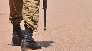 A Burkina Faso's soldier patrols to ensure security measures during Burkina Faso's cycling tour, in Ouahigouya, on October 29, 2018.