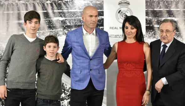 Real Madrid's new manager Zinedine Zidane poses with his wife Veronique, two of their sons, and Real Madrid's president Florentino Perez on January 4, 2016.