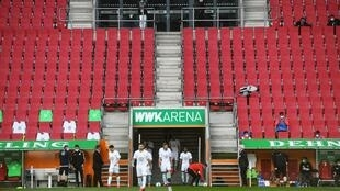 Is there anybody there? Wolfsburg players come onto the pitch prior to their game at Augsburg