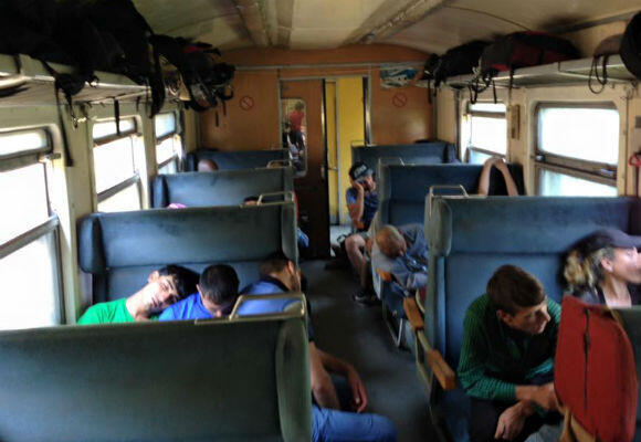 Migrants get some rest on the train bound for Serbia. This a vast improvement on the situation before the summer, when migrants were not allowed on public transport and had to walk across Macedonia. (Photo: Fernande van Tets)