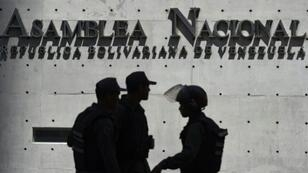 Members of Venezuela's Bolivarian National Guard outside the Federal Legislative Palace, which houses both the opposition-led National Assembly and the pro-government National Constituent Assembly, in Caracas on May 15, 2019