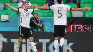 Robin Gosens (L) celebrates scoring Germany's fourth goal in Munich on Saturday at Euro 2020