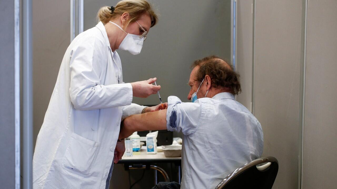 A man is vaccinated against the coronavirus in Paris, France, on March 16, 2021.