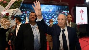 Beji Caid Essebsi (right), head of the Nidaa Tounes party