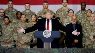 FILE PHOTO: U.S. President Donald Trump delivers remarks to U.S. troops, with Afghanistan President Ashraf Ghani standing behind him, during an unannounced visit to Bagram Air Base, Afghanistan, November 28, 2019.