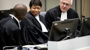 The US visa of ICC chief prosecutor Fatou Bensouda (C) was revoked over a possible probe involving American soldiers' actions since 2003 in the bloody Afghan conflict