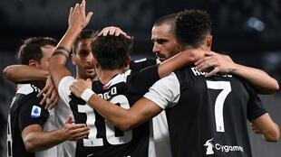 Juventus forward Cristiano Ronaldo celebrates with teammates after scoring a goal against Lazio in Turin.