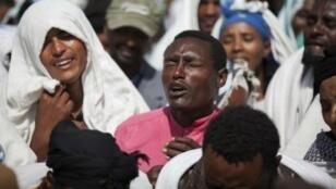 En décembre 2015, des Éthiopiens portent le deuil d'un homme tué par les forces armées dans le village de Yubdo, lors de manifestations.