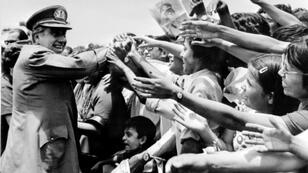 Now-deceased former dictator Augusto Pinochet, who established a bloody regime between 1973 and 1990, meets cheering crowds in Santiago in 1975