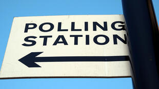 A polling station sign is seen ahead of the forthcoming general election in London