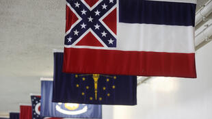 The Mississippi state flag, which incorporates the Confederate battle flag, hangs with other state flags in the subway system under the U.S. Capitol in Washington, U.S. June 30, 2020.