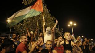 Les Gazaouis sont descendus dans la rue pour célébrer le cessez-le-feu, mardi soir.