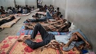 (FILES) In this file photo taken on June 17, 2017 illegal immigrants are seen sleeping at a detention centre in Zawiyah, 45 kilometres west of the Libyan capital Tripoli. The heads of two refugee agencies have called for refugees and migrants held in Libyan centres to be freed and for countries to take them in