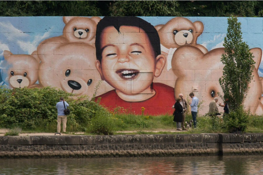 A graffiti by artists Justus Becker and Oguz Sen depicts the drowned Syrian refugee boy Alan Kurdi in Frankfurt am Main, Germany, on July 4, 2016.