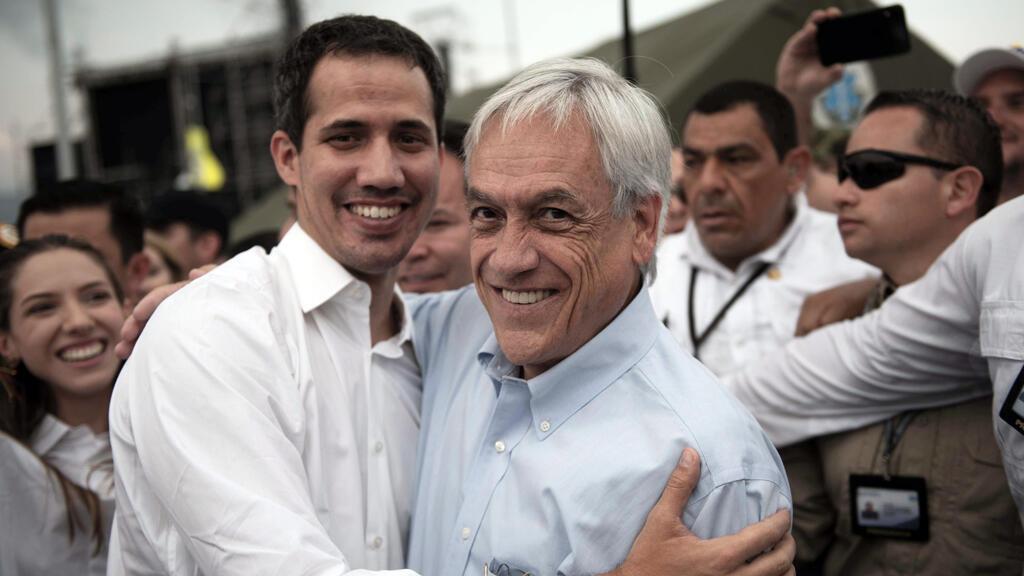 """El presidente de Chile, Sebastián Piñera y el líder de la oposición venezolana Juan Guaidó asisten al concierto """"Venezuela Live Aid"""" en el puente transfronterizo Tienditas entre Colombia y Venezuela."""