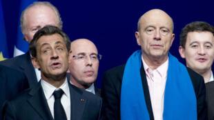 Nicolas Sarkozy et Alain Juppé lors du Conseil national de l'UMP, le 8 février, à Paris.