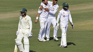 Pakistan's Yasir Shah (2L) took four wickets and teammate Nauman Ali (2R) took five in South Africa's second innings