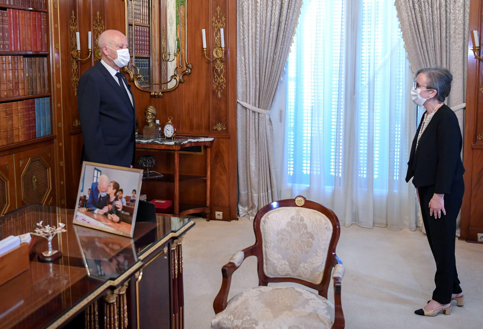 Tunisia's newly named prime minister-designate Najla Bouden, a political unknown with a background in geology, meets with President Kais Saied