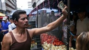 In some Caracas shops and markets, vendors are only accepting cash -- dollars or bolivars -- making it harder for some people to buy basic foods