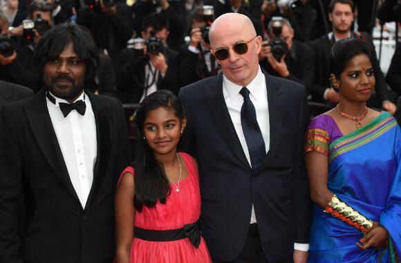 "From left to right: Antonythasan Jesuthasan, Claudine Vinasithamby, Jacques Audiard, and Kalieaswari Srinivasan attend the ""Dheepan"" premiere in Cannes."