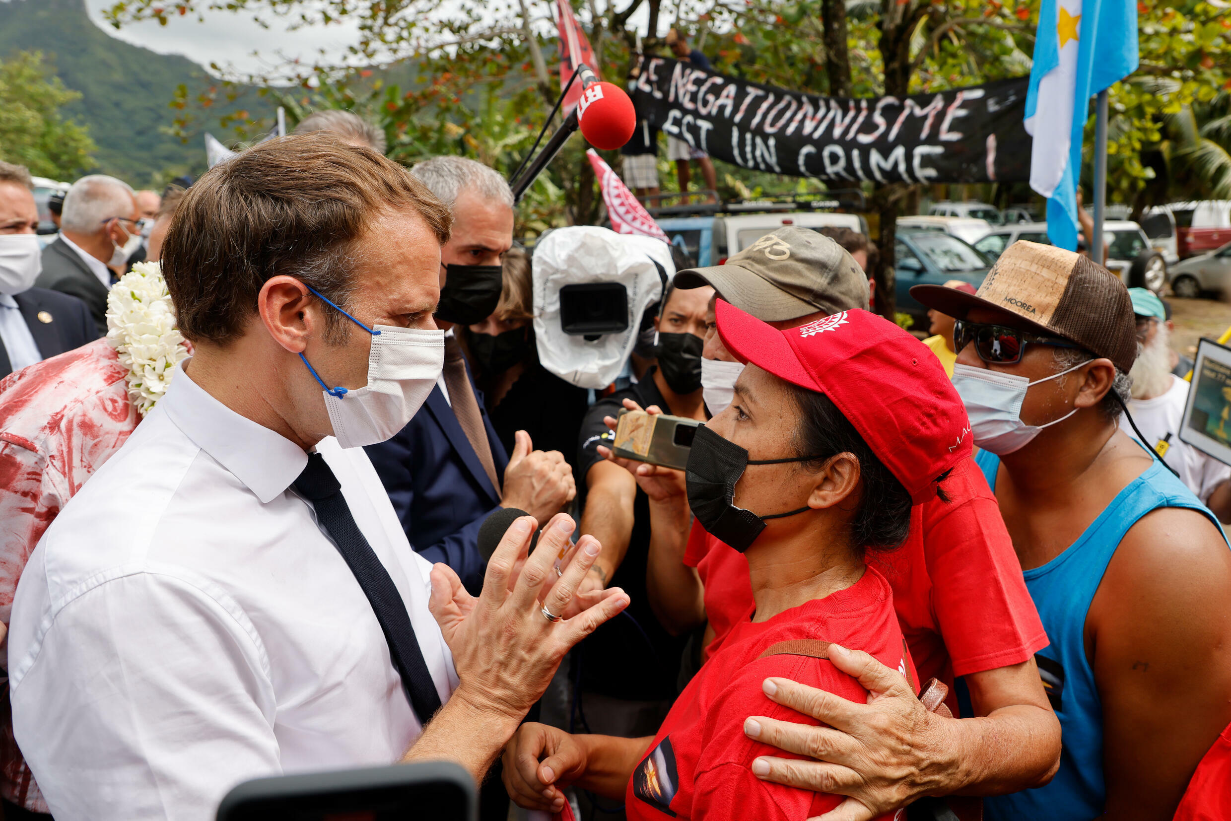 French President Emmanuel Macron stopped by the side of the road to talk to anti-nuclear protestors in French Polynesia