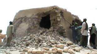 A still from a video shows jihadists destroying an ancient shrine in Timbuktu in 2012