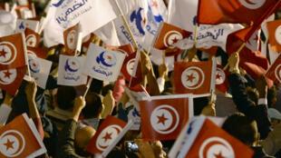 Des partisans d'Ennahda lors d'un meeting, le 27 octobre 2014.
