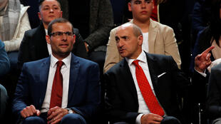 Robert Abela (L), a 42-year-old lawyer whom Labour Party voters elected as the party's leader and Malta's next prime minister, sits with fellow leadership candidate Chris Fearne (R) at outgoing Prime Minister and party leader Joseph Muscat's final speech at the party's Congress at the Corradino Sports Pavilion in Paola, Malta on January 10, 2020.
