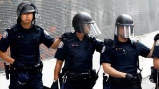 Des policiers à Toronto, en juin 2010.
